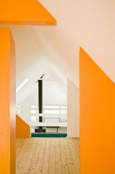 A farmhouse in the southernmost Swedish region of Skåne, converted into a summerhouse by LASC Studio in Copenhagen. In the interiors, the wood surfaces are bleached with lye and finished with oil to create a uniform lightness, offset by bolts of unexpected bright colors in the stairwells and hallways.