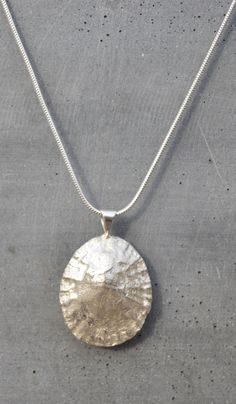 "Emily Nott-Bower Watergate seashell necklace. A beautiful solid silver limpet shell on a 16"" sterling silver snake chain. Designed on a shell that has been picked from Watergate Bay beach. £69"