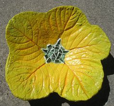 One of my cement flowers made from overlapping leaves, mosaic center and painted.