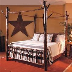 A log poster bed by Rocky Mountain Cabin Decor.