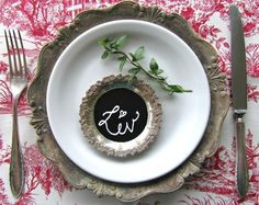 use blackboard paint on old silver trays to re-purpose them into place cards!