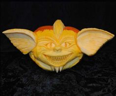 Danny K. of Newville, PA used clay sculpting tools, a battery powered jigsaw, and different grades of sandpaper to create this creepy gremlin for our 2012 Pumpkin-Carving Contest. | thisoldhouse.com