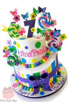 Ana's 7th birthday cake with colorful lollipop fondant swirls, and fondant flowers.  Happy Birthday Ana!