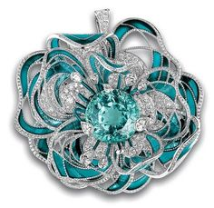 The standout of Chanel Fine Jewelry's high-jewelry collection—a camellia brooch—was inspired by a single rare stone: a 38-carat, blue-green Paraiba tourmaline, which in the brooch is encircled by diamonds and sea-blue enamel