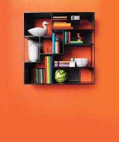 If books are not a storage challenge in your home, recast your bookcases for other uses.
