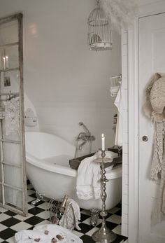 Birdcages to hold bath sponges...adore this bath!!!