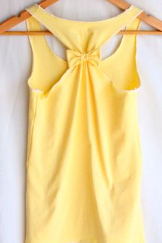 Yellow top with bow.