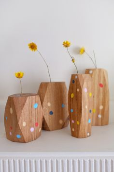 Wooden confetti vases.