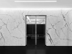 Saint Laurent open a new flagship boutique located on Avenue Montaigne in Paris, showcasing women's and men's ready-to-wear accessories. Designed by Hedi Slimane, the art deco-inspired store features minimal lines, marble and mirrors.