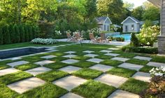 Checkerboard pattern created with lawn and large paving stones give this yard a fun, whimsical look.