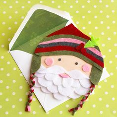 Ho ho ho! Send Christmas cheer to your friends with this adorable Felt Santa Claus Christmas Card: http://www.bhg.com/christmas/cards/homemade-christmas-cards/?socsrc=bhgpin120713feltsanta&page=9