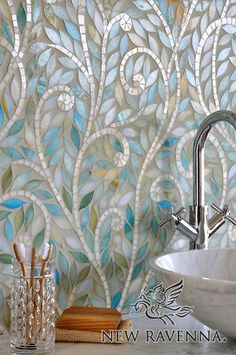 Climbing Vines, a jewel glass waterjet mosaic, is shown in Aquamarine leaves and Quartz vines by New Ravenna . mosaic backsplash, tile, mosaic bath