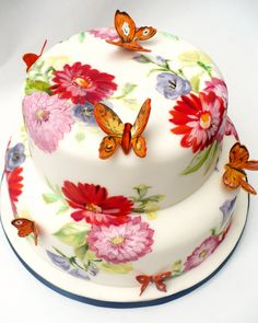 Butterfly cake.  Love the combination of painting on fondant and the 3-D butterflies. Nice combo of techniques.