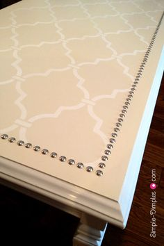 DIY Stencil Nailhead Coffee Table    Great Tutorial and Awesome Blog! Never thought to put nailhead on the top of a table!