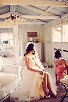 bride getting ready, photo by Tamiz Photography http://ruffledblog.com/haiku-mill-wedding #bridal #brides