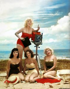 Model and photographer Bunny Yeager poses with some her models, Miami Beach, 1955