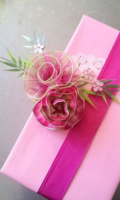 gift wrap - a bit to do - spring pink ribbon roses on large box with heart doily, artif.green, rhinestones / DIY tutorial - http://la-couronne.de/ Giftwrap, Gift Wrapping, Silk Ribbon, Gift Packaging, Pink Ribbons, Ribbon Rose, Wrapping Large Gifts, Ribbon Flower