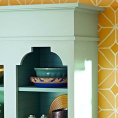 Add economical custom touches to your existing cabinets for a kitchen with a whole new look.