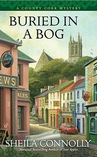 Buried in a Bog by Sheila Connolly  This author writes about small town mysteries.   She has a series that takes place in a little town in Ireland.