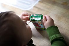Teach your child to pick up a juice box by the side flaps.
