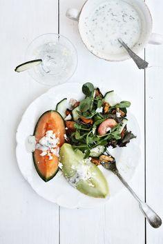 melOn salad with plums, green leaves, cucumber, seafood, feta  lemon mint yogurt dressing