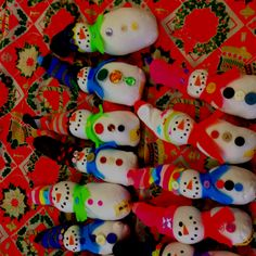 Sock Snowmen: Use an ankle sock for the body, fill 1/4 of the way with beans or rice and the rest with poly-fil, tie off neck and top of sock with rubber band and hot glue felt scarf.  Add a colorful baby sock for the snowman's hat and embellish with buttons and fabric paint.