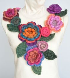 Crocheted flower and vine scarf.  Its from etsy, so there's no pattern.  But it shows a good layout for crochet flowers that looks easy to copy.