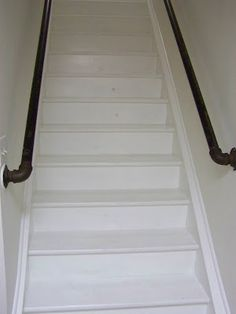 Plumbing pipes as stair rail.... The first even not ugly tacky stair rail