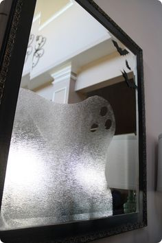 Use textured transparent vinyl (contact paper?) to make a ghost in the mirror for Halloween.