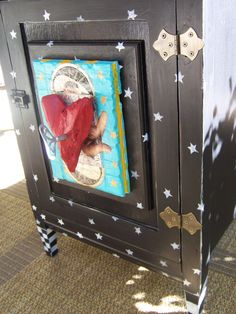old Victrola cabinet   collage+ paint = happiness