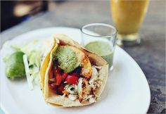 Fish tacos with grilled peppers and peaches and poblano cilantro sauce - definitely have to try this one.
