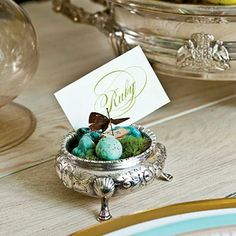 Refined Thanksgiving Table | Place cards are tucked in an array of silver saltcellars filled with moss, turquoise stones, and butterflies for personalized, individual versions of the centerpiece. | SouthernLiving.com