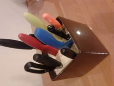 Fill any creative vessel with rice to hold different shaped cutlery. Great for make-up brushes too.