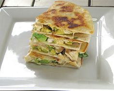 Avocado Chicken Quesadillas. These are delicious! You have to be crafty when flipping them in the pan so the inside stuff doesn't fall out. ~Lacie~