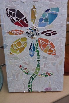 Mosaic using waste glass we have tumbled to resemble beach glass.