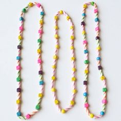 Turn your stash of striped straws into beads for this colorful kids' necklace.