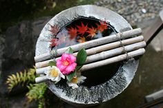 Tsukubai a stone water basin for visitors to rinse their hands and