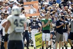 BYU quarterback Christian Stewart (7) holds up a sign during the spring scrimmage at LaVell Edwards Stadium on Saturday, March 30, 2013. (Chris Detrick  |  The Salt Lake Tribune)