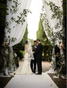 We LOVE the drama these grand drapes add for your ceremony at the Chicago Botanic Gardens. Jason Kaczorowski Photography.