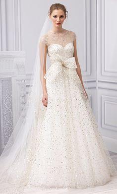 Monique Lhuillier.  KT's wedding dress style.