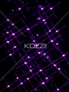 cluster of purple lights. - Cluster of purple lights over black background.