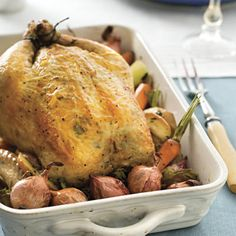 I must try this....Garlic-Herb Roasted Chicken. Apples and vegetables infuse the chicken with amazing flavor. After baking, unpeeled shallots slip easily from their papery skins adding a tasty side note to the sliced chicken. Doesn't this sound GREAT?!!