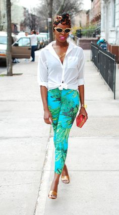 cool head wrap White shirt green bottoms