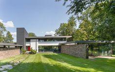 $7.5M Lakehouse Was Designed Around Midcentury Furniture