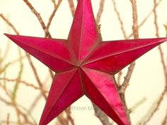 make a tin star from a disposable baking pan from the dollar store!  http://dollarstorecrafts.com/2010/12/make-3d-tin-craft-stars/