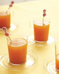 Hot apple cider garnished with sugared cranberries--the perfect fall cocktail #MeyersStyles