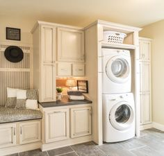 This has got to be the mother of all mud rooms! A great laundry area.