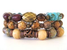 An eclectic mix of gemstones, bone and metal make up this gorgeous beaded stretch bracelet stack. Featuring 10mm African opal beads, 10mm antique bone beads, 8mm picture jasper beads, 8mm teal impression jasper beads, Buri seed beads, coconut pukalet beads, turquoise magnesite heishi beads and a mix of metals including antiqued brass and antiqued copper accent beads. Such a fun array of textures and colors, this bracelet set is a great addition to any wardrobe!
