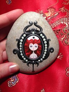 that's a lovely piece of art. decorated stone that can be an eye catching paper presser or just a stone.