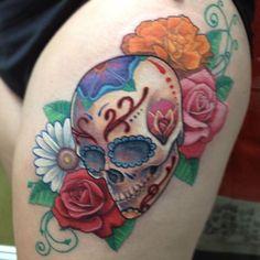 Taylor's Sugar Skull tattoo.